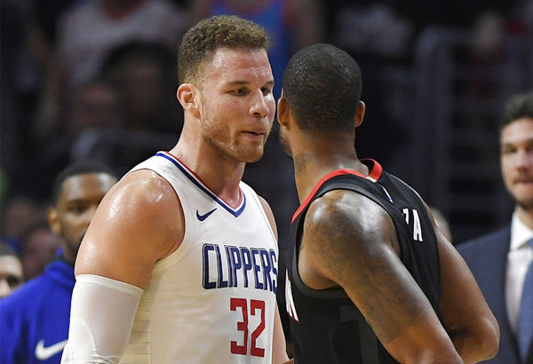 Los Angeles Clippers forward Blake Griffin, left, and Houston Rockets forward Trevor Ariza have words before both of them were ejected in the closing seconds of an NBA basketball game, Monday, Jan. 15, 2018, in Los Angeles. The Clippers won 113-102. | AP Photo/Mark J. Terrill