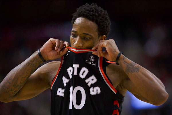 Toronto Raptors guard DeMar DeRozan reacts during a timeout in the second half of the team's NBA basketball game against the Golden State Warriors on Saturday, Jan. 13, 2018, in Toronto. | Cole Burston/The Canadian Press via AP