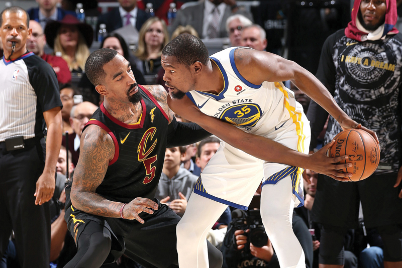 Kevin Durant of the Golden State Warriors looks for an open lane under pressure from JR Smith of the Cleveland Cavaliers at Quicken Loans Arena in Cleveland, Ohio. AFP