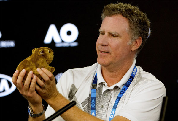 US actor Will Ferrell holds up a toy wombat during a press conference at the Australian Open tennis championships in Melbourne, Thursday, Jan. 18, 2018. | Fiona Hamilton/Tennis Australia via AP