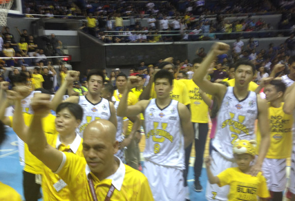 The University of Santo Tomas Growling Tigers singing their school hymn shortly after booking their UAAP Fianls ticket at the expense of the National University Bulldogs. Philstar.com