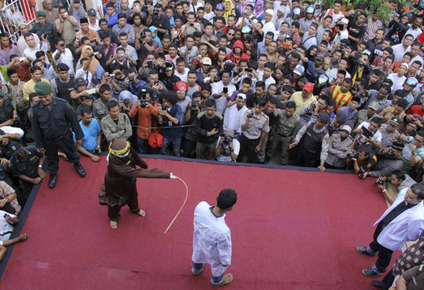 punishing with caning takes effect indonesia