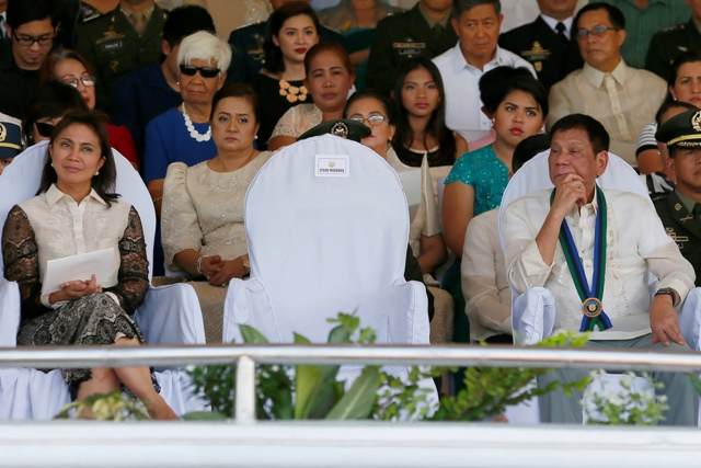 Vice President Leni Robredo and President Rodrigo Duterte at the Armed Forces of the Philippines turnover ceremony, July 1, 2016. AP/Bullit Marquez