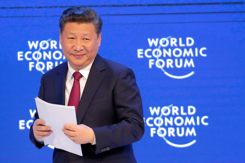 FILE - In this Jan. 17, 2017, file photo, China's President Xi Jinping smiles to the audience after his speech at the World Economic Forum in Davos, Switzerland. Economic concerns remain foremost for the leadership and officials have responded to complaints from U.S. President Donald Trump and others over alleged unfair trade practices by again arguing against restrictions on the export of sensitive U.S. technologies, along with growing negative sentiment against Chinese investment in economies overseas that keep companies such as communications giant Huawei out of the U.S. market. AP/Michel Euler, File