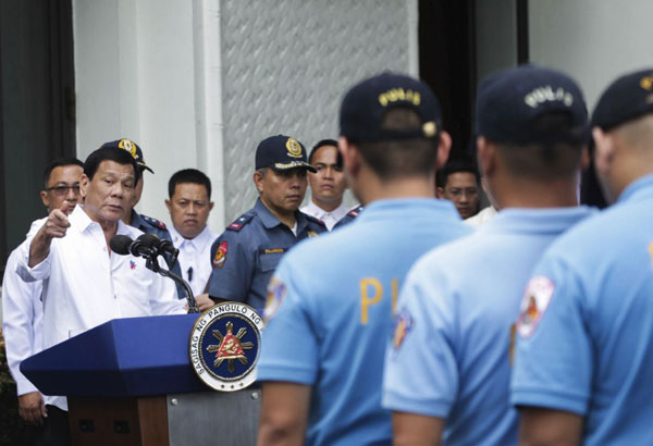 """President Rodrigo Duterte said the dismissal of the policemen is part of a """"purging"""" at the Philippine National Police, which he once described as """"corrupt to the core."""" Robinson Ninal/Presidential Photographers Division, Malacanang Palace via AP, File"""