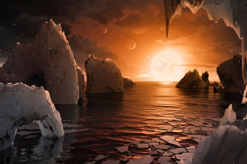 This image provided by NASA/JPL-Caltech shows an artist's conception of what the surface of the exoplanet TRAPPIST-1f may look like, based on available data about its diameter, mass and distances from the host star. The planets circle tightly around a dim dwarf star called Trappist-1, barely the size of Jupiter. Three are in the so-called habitable zone, where liquid water and, possibly life, might exist. The others are right on the doorstep. NASA/JPL-Caltech via AP