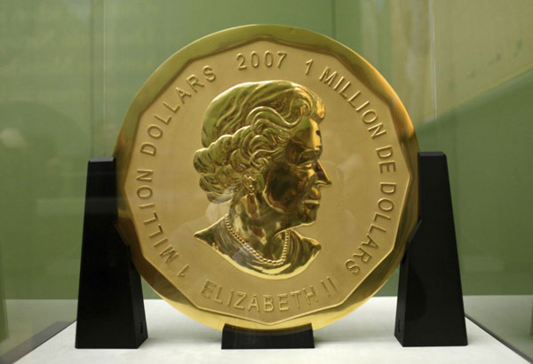 FILE - The Dec. 12, 2010 file photo shows the gold coin 'Big Maple Leaf' in the Bode Museum in Berlin. The 100-kilogram (220 pound) gold coin disappeared from the museum. (Marcel Mettelsiefen/dpa via AP)