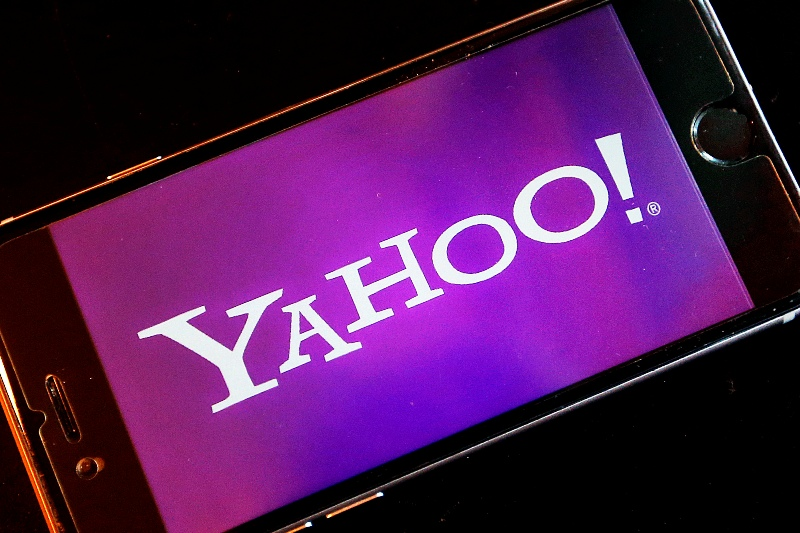 FILE - In this Dec. 15, 2016, file photo, the Yahoo logo appears on a smartphone in Frankfurt, Germany. In a regulatory filing on Monday, March 13, 2017, Yahoo named the top executives who will lead what's left of the company after its business is sold to Verizon. Current CEO Marissa Mayer will stay at Yahoo until the $4.48 billion Verizon deal closes, expected by the end of June 2017. The filing did not say what will happen to her position after this. AP/Michael Probst, File