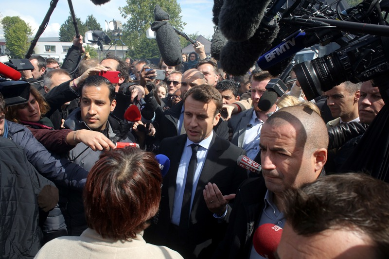 French centrist presidential election candidate Emmanuel Macron, center, talks to workers at the Whirlpool home appliance factory, Wednesday April 26, 2017 in Amiens, northern France. Far-right French presidential candidate Marine Le Pen has earlier upstaged Macron as she made a surprise campaign stop to the plant. AP/Thibault Camus