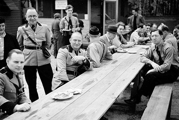 In this May 22, 1938 photo, provided by the New York City Municipal Archives, members of the German American Bund pose for a photo at Camp Siegfried, in Yaphank, N.Y. The enclave of former summer bungalows, where Nazi sympathizers once proudly marched near streets named for Adolf Hitler and other Third Reich figures, is being forced to end policies that limited ownership to people of German descent. New York City Municipal Archives via AP