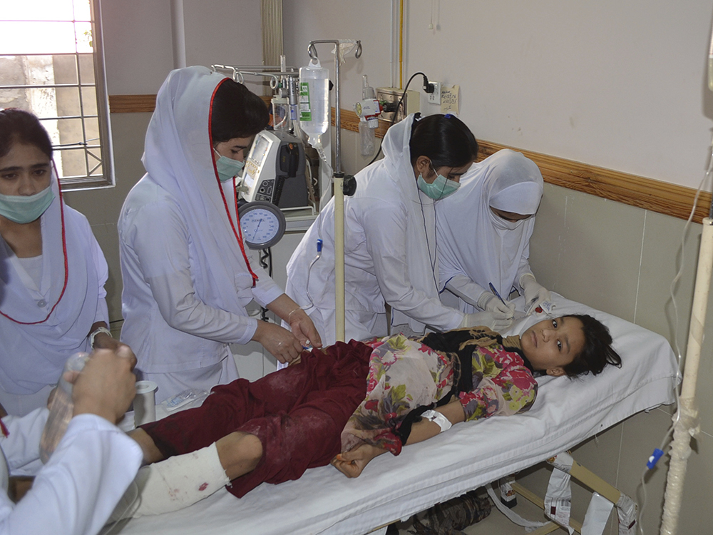 Pakistani nursing staff attend an injured girl at a hospital in Quetta, Pakistan, Friday, June 23, 2017. A powerful bomb went off near the office of the provincial police chief in southwest Pakistan on Friday, causing casualties, police said. AP/Arshad Butt