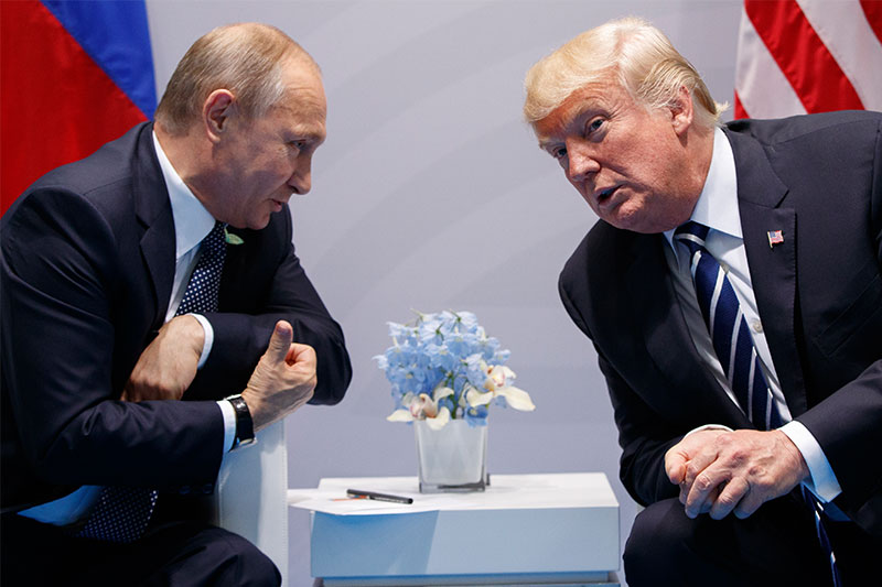 In this Friday, July 7, 2017, file photo U.S. President Donald Trump meets with Russian President Vladimir Putin at the G-20 Summit in Hamburg. A separate US-Russia-brokered truce for southern Syria, brokered by the U.S. and Russia, is meant to help allay growing concerns by neighboring Jordan and Israel about Iranian military ambitions in the area.AP/Evan Vucci, File