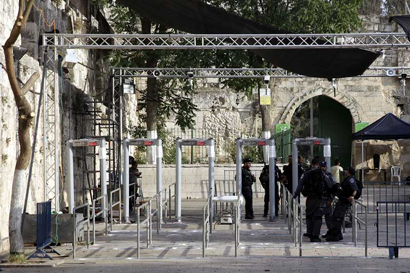 Israeli police officers are seen outside the Al Aqsa Mosque compound in Jerusalem's Old City, Monday, July 24, 2017. Israeli media reports high resolution cameras placed around Jerusalem's Old City walls could replace the metal detectors that sparked Muslim outrage after they were set outside entrances to a major shrine. AP/Mahmoud Illean