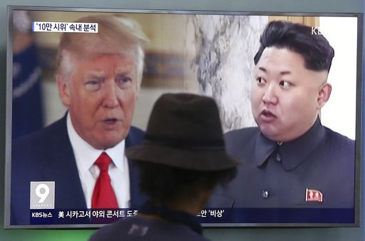 A man watches a television screen showing President Donald Trump and North Korean leader Kim Jong Un during a news program at the Seoul Train Station in Seoul, South Korea, Thursday, Aug. 10, 2017. AP/Ahn Young-joon, file