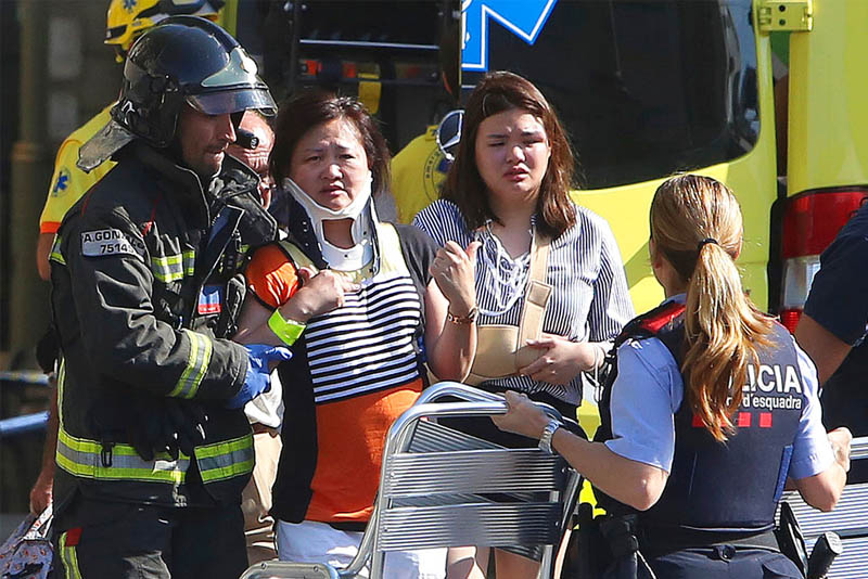Police yesterday shot and killed five people wearing fake bomb belts who staged a car attack in a seaside resort in Spain's Catalonia region hours after a van plowed into pedestrians on a busy Barcelona promenade, killing at least 14 people and injuring over 100 others. AP/Oriol Duran, File