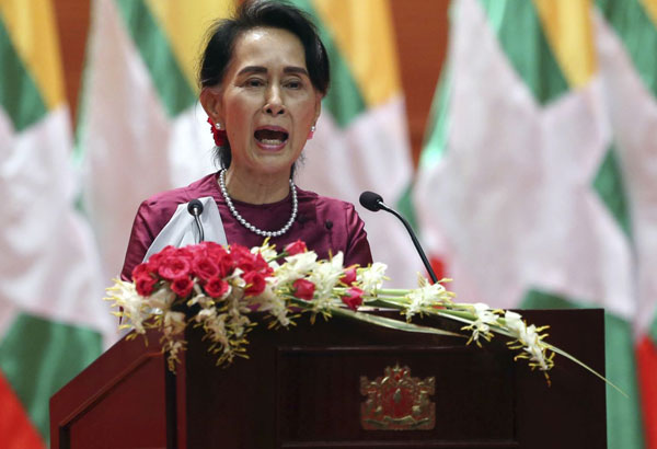 Myanmar's State Counsellor Aung San Suu Kyi delivers a televised speech to the nation at the Myanmar International Convention Center in Naypyitaw, Myanmar, Tuesday, Sept. 19, 2017. After a mass exodus of Rohingya Muslims sparked allegations of ethnic cleansing, Myanmar leader Aung San Suu Kyi said Tuesday her country does not fear international scrutiny. (AP Photo/Aung Shine Oo)