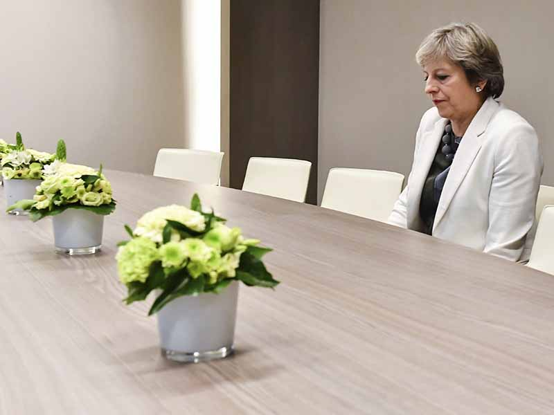 British Prime Minister Theresa May waits for the arrival of European Council President Donald Tusk prior to a bilateral meeting with European Council President Donald Tusk during an EU summit in Brussels on Friday, Oct. 20, 2017. European Union leaders gathered Friday to weigh progress in negotiations on Britain's departure from their club as they look for new ways to speed up the painfully slow moving process. AP/Geert Vanden Wijngaert, Pool