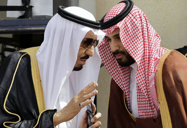 FILE - In this May 14, 2012 file photo, King Salman, left, speaks with his son, now Crown Prince Mohammed Bin Salman, (MBS), as they wait for Gulf Arab leaders ahead of the opening of Gulf Cooperation Council, in Riyadh, Saudi Arabia. The surprise dismissal and arrest of dozens of ministers, royals, officials and senior military officers by MBS late Saturday, Nov. 4, 2017, is unprecedented in the secretive, 85-year-old kingdom. But so is the by-now virtually certain rise to the throne of a 30-something royal who, in another first, is succeeding his father. (AP Photo/Hassan Ammar, File)