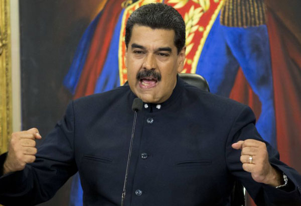FILE - In this Oct. 17, 2017 file photo, Venezuela's President Nicolas Maduro speaks during a press conference at the Miraflores presidential palace, in Caracas, Venezuela. The EU on Monday Nov. 13, 2017 banned arms sales to Venezuela and set up a system to slap asset freezes and travel restrictions on Venezuelan officials as it seeks to ramp up pressure on President Nicolas Maduro. The move was decided by EU foreign ministers at talks in Brussels. (AP Photo/Ariana Cubillos, File)