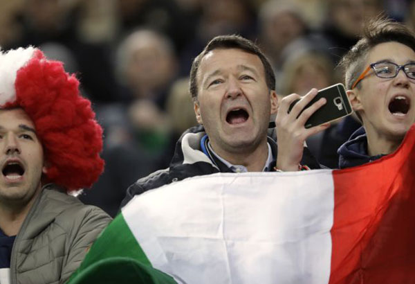 Fans of the Italian team cheer prior to the World Cup qualifying play-off second leg soccer match between Italy and Sweden, at the Milan San Siro stadium, Italy, Monday, Nov. 13, 2017. (AP Photo/Luca Bruno)