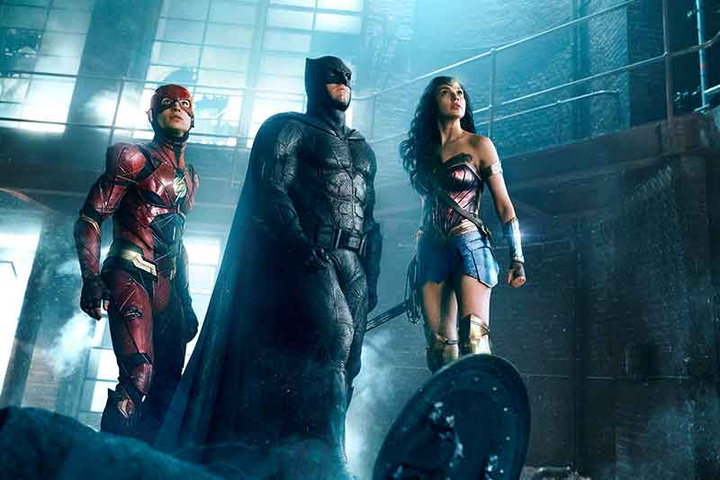 """This image released by Warner Bros. Pictures shows Ezra Miller, from left, Ben Affleck and Gal Gadot in a scene from """"Justice League."""" Warner Bros. Entertainment Inc. via AP"""
