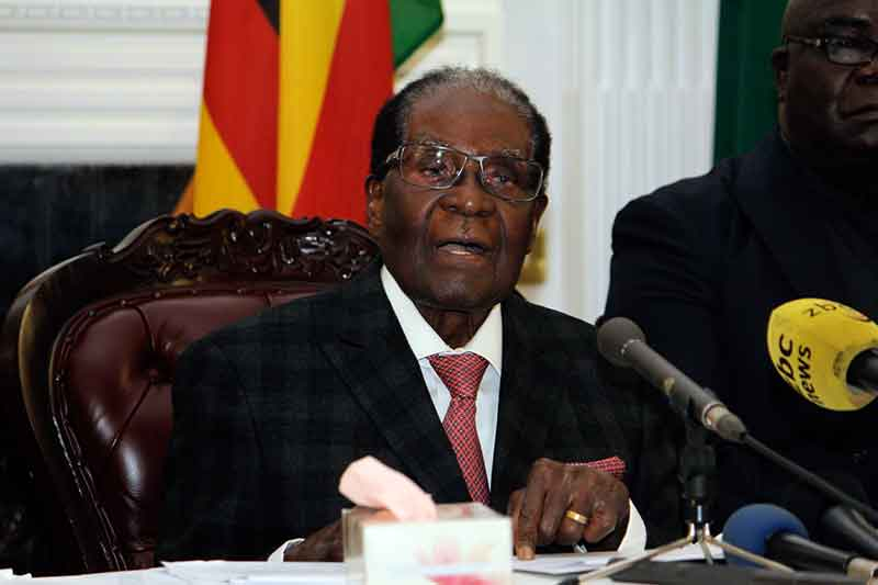 Zimbabwean President Robert Mugabe delivers his speech during a live broadcast at State House in Harare, Sunday, Nov, 19, 2017. Zimbabwe's President Robert Mugabe has baffled the country by ending his address on national television without announcing his resignation. AP