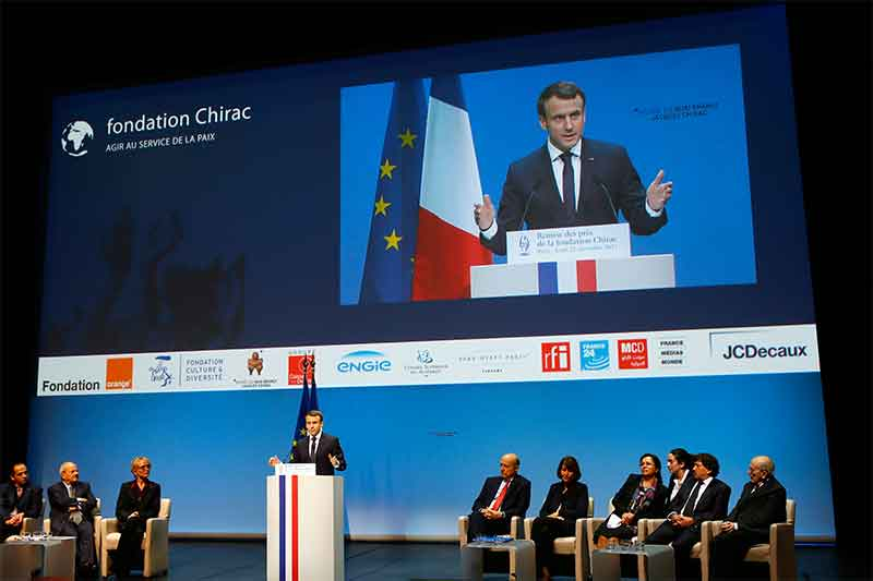 French President Emmanuel Macron delivers his speech at the Fondation Chirac Prize ceremony at Quai Branly Museum in Paris, France, Thursday, Nov. 23, 2017. The Fondation Chirac Prize is awarded to one or more private individuals and aims to improve awareness and support those who are discreetly working , often risking their lives, to break the cycles of conflict in the world. AP/Francois Mori, pool