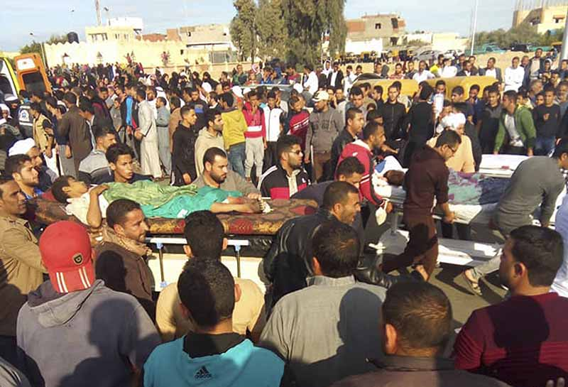 Injured people are evacuated from the scene of a militant attack on a mosque in Bir al-Abd in the northern Sinai Peninsula of Egypt on Friday, Nov. 24, 2017. In the deadliest-ever attack by Islamic extremists in Egypt, militants assaulted a crowded mosque Friday during prayers, blasting helpless worshippers with gunfire and rocket-propelled grenades and blocking their escape routes. More than 200 people were killed before the assailants got away. AP