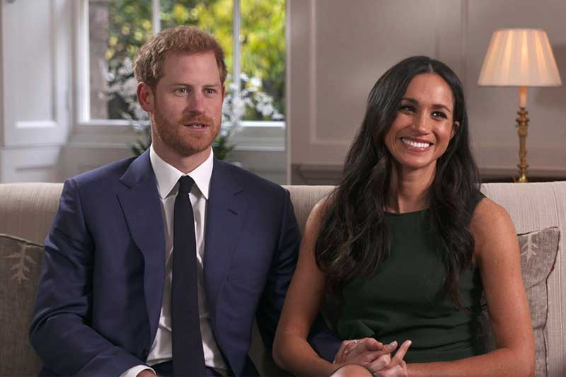 In this photo taken from video Britain's Prince Harry and Meghan Markle talk about their engagement during an interview in London, Monday, Nov. 27, 2017. It was announced Monday that Prince Harry, fifth in line for the British throne, will marry American actress Meghan Markle in the spring, confirming months of rumors. Pool via AP