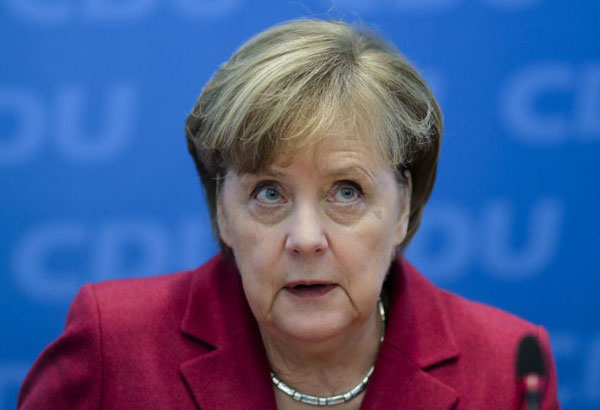 Christian Democratic Union party chairwoman and German Chancellor Angela Merkel attends a party's leaders meeting at the headquarters in Berlin, Monday, Dec. 11, 2017. (AP Photo/Markus Schreiber)