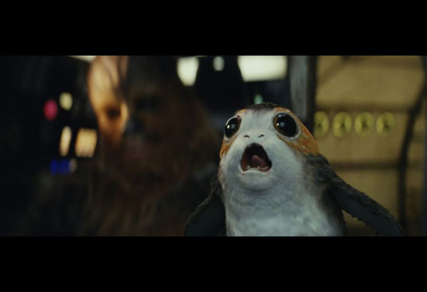 """This image released by Lucasfilm shows Chewbacca, left, and a Porg in a scene from """"Star Wars: The Last Jedi."""" (Lucasfilm via AP)"""