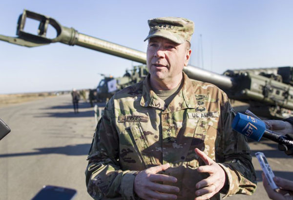 FILE - In this March 24, 2016 file photo Commander of U.S. Army Europe Lt. Gen. Ben Hodges speaks to the media during the joint NATO military exercise at the Rukla military base some 120 km. (75 miles) west of the capital Vilnius, Lithuania. Hodges will is retiring. (AP Photo/Mindaugas Kulbis, file)