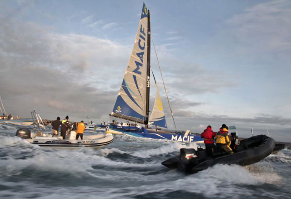 The 30m MACIF trimaran of French skipper Francois Gabart reaches the Brest harbor, western France, Sunday, Dec. 17, 2017. Gabart has broken the record for sailing around the world alone, circumnavigating the planet in just 42 days and 16 hours. (AP Photo/Thibault Camus)