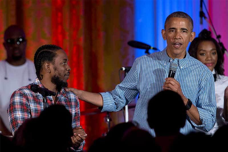 FILE - In this Monday, July 4, 2016, file photo, President Barack Obama, joined by Kendrick Lamar, speaks during an Independence Day celebration for members of the military and their families, at the White House, in Washington. Lamar, U2, Jay-Z, Harry Styles and Chris Stapleton were just some of the artists responsible for Obama's favorite songs of 2017. AP/Carolyn Kaster, File