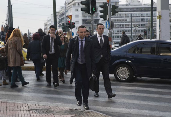 Deputy Prime Minister of Macedonia Bujar Osmani center, walks downtown Athens as he arrives for a meeting with Greek Alternate Minister of Foreign Affairs George Katrougalos on Tuesday, Jan. 9, 2018. Osmani is in Greece as the two countries have agreed to resume efforts to try and resolve a long-standing name dispute that began after the tiny Balkan republic gained independence from Yugoslavia. (AP Photo/Petros Giannakouris)