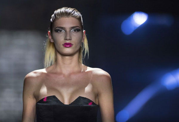 """FILE - the July 7, 2017 file photo shows model Giuliana who became well known with the show """"Germany's Next Topmodel"""" during a fashion show in Berlin. Germany's edition of Playboy magazine said it will be featuring the transgender model on its cover for the first time ever this month. (Serene Stache/dpa via AP)"""