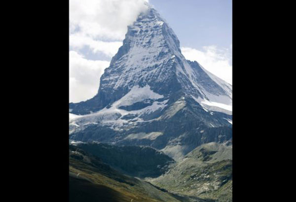 FILE - A July 30 2011 file picture shows the famous Matterhorn mountain near Zermatt, Switzerland. Swiss authorities near the famed Matterhorn peak on Tuesday Jan. 9, 2018 closed ski slopes, hiking trails, cable cars, roads and train service into the nearby town of Zermatt amid a heightened risk of avalanches, stranding some 13,000 tourists in the town. (Jean-Christophe Bott/Keystone via AP, File)