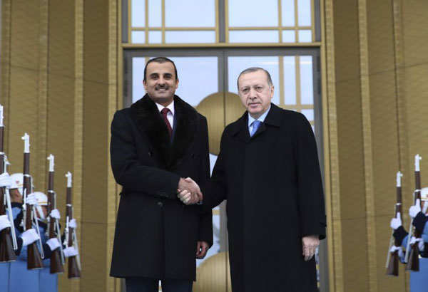 Turkey's President Recep Tayyip Erdogan, right, shakes hands with Qatar's Sheikh Tamim bin Hamad Al Thani, prior to their meeting in Ankara, Turkey, Monday, Jan. 15, 2018. Al Thani's visit comes as the United Arab Emirates on Monday claimed that Qatari fighter jets intercepted two of its commercial airliners in international airspace on the way to Bahrain, allegations promptly denied by a Doha official. (Yasin Bulbul /Pool Photo via AP)