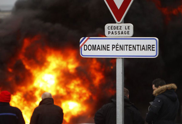Penitentiary staff demonstrate outside the prison in Vendin le Vieil, northern France, Monday Jan.15, 2018. Penitentiary staff block several prisons in France after an attack by an inmate against several people at the high-security prison of Vendin le Vieil on Thursday Jan.11 2018 in northern France. (AP Photo/Michel Spingler)
