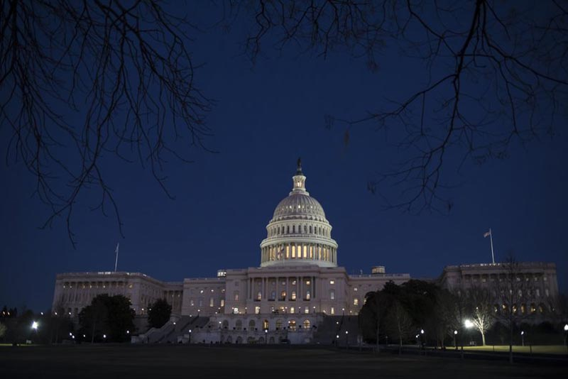 The Capitol is illuminated in Washington, Friday evening, Jan. 19, 2018. AP Photo/J. Scott Applewhite, file