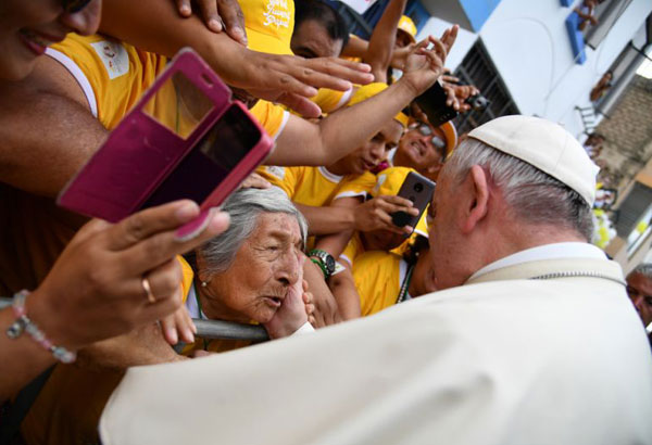 "Pope Francis greets a woman after blessing her as he toured around the Plaza de Armas, in Trujillo, Peru, Saturday, Jan. 20, 2018. Francis consoled Peruvians who lost their homes and livelihoods in devastating floods last year, telling them Saturday they can overcome all of life's ""storms"" by coming together as a community and stamping out the violence that plagues this part of the country. (Vincenzo Pinto/AFP Pool Photo via AP)"
