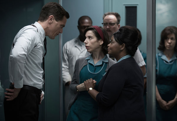 """This image released by Fox Searchlight Pictures shows Michael Shannon, from left, Sally Hawkins and Octavia Spencer in a scene from the film, """"The Shape of Water."""" Guillermo del Toro's Cold War fantasy tale will vie for the most nominations for the 90th annual Academy Awards. (Fox Searchlight Pictures via AP)"""