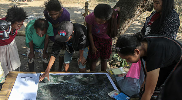 """Aeta residents participate in the counter-mapping activity of the UP Department of Geography. The department says on its blog that counter-mapping is """"a participatory mapping methodology for the production of maps that communities can use in their struggle for their land rights."""
