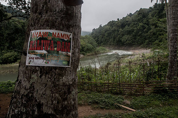 A poster saying 'We are against Kaliwa Dam' is posted on a tree at Queborosa village in Infanta, Quezon