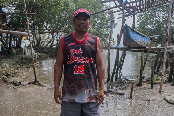 Teody Bacon says he can earn from P300 to P500, sometimes even more,  in just a few hours of fishing. Relocating somewhere away from the sea is something he and other residents cannot accept.