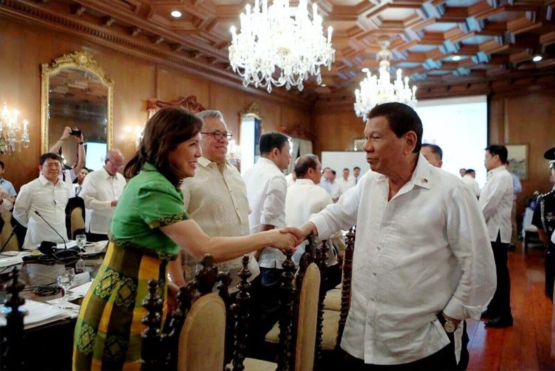 President Duterte greets Tourism Secretary Wanda Teo prior to the start of the 25th Cabinet meeting at Malacañang yesterday