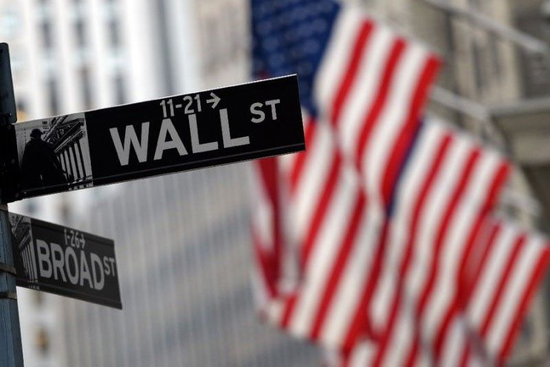 Wall Street woes drag local stocks down