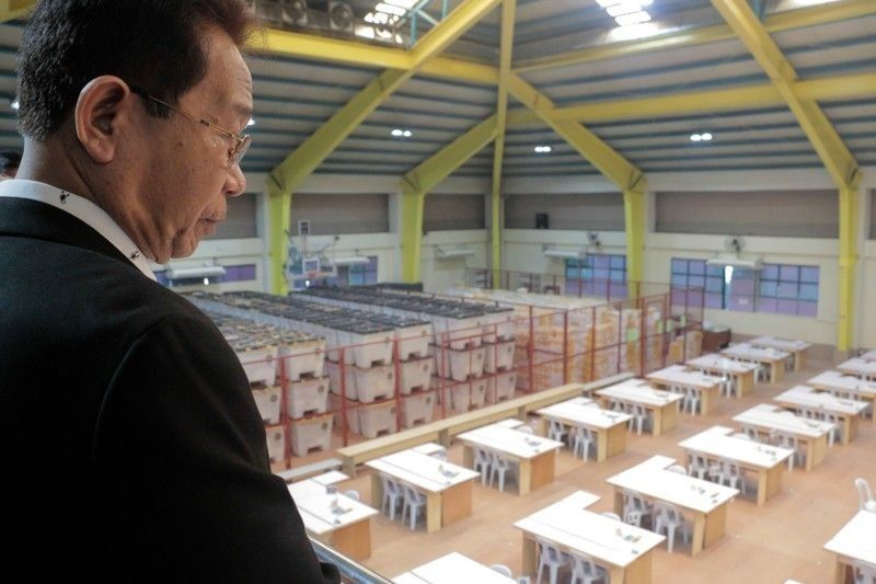 In this photo taken on March 27, Presidential Electoral Tribunal AdHoc committee member, Edgar Aricheta, oversees the venue for the ballot recount.