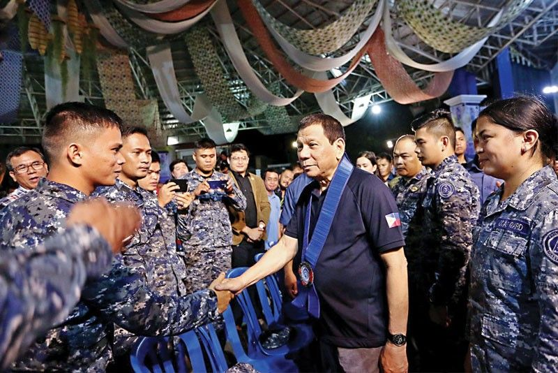 President Duterte greets soldiers at the First Subaraw Biodiversity Festival held at the People�s Ampitheater in Puerto Princesa City, Palawan on Nov. 10.