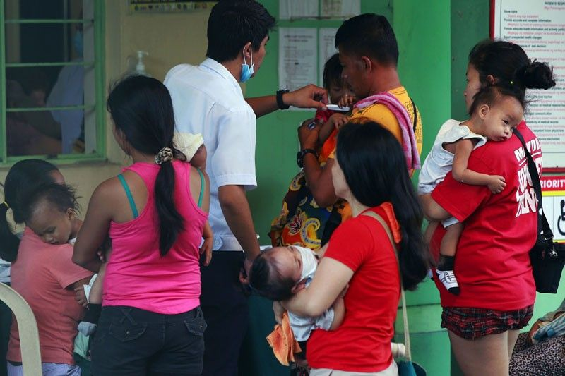 In an interview yesterday, Health Secretary Francisco Duque III said they decided to conduct two levels of immunization activities to effectively curb the rise of measles in the country.Philstar.com/File Photo